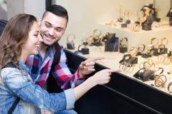 Adults  looking at shopwindows Stock Image