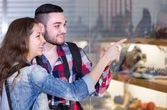 Adults  looking at shopwindows Royalty Free Stock Image