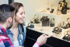 Adults looking at shopwindows Royalty Free Stock Photo
