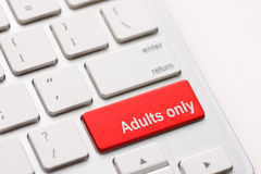 Adults only message on enter key. For pornography websites concepts Stock Photos