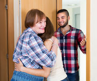Adults people greeting mother Stock Image