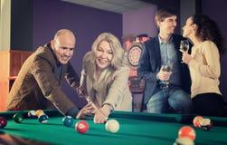 Adults people having pool game. In billiard club Stock Image