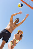 Adults people playing volleyball at beach Royalty Free Stock Photography