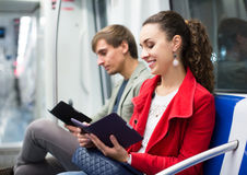 Adults people reading smartphone and e-book. In metro car stock image