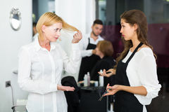 Adults person quarrels about haircut. In the barbershop Stock Photos