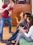 Adults playing charades Stock Photo