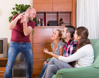 Adults playing charades Royalty Free Stock Image