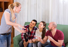 Adults playing charades. Happy russian adults playing charades indoor and laughing Stock Images