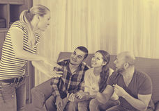 Adults playing charades Royalty Free Stock Image