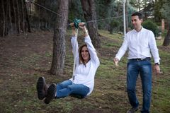 Adults playing on the zip line at home royalty free stock photo