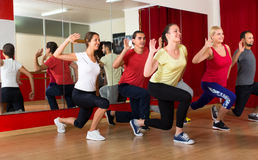Adults practicing in dancing school Stock Images