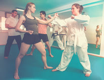 Adults are practicing new karate moves in pairs Stock Photography