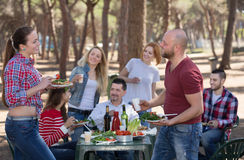Adults relaxing at grill party Royalty Free Stock Photo