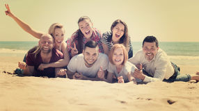 Adults relaxing at sandy beach. Happy adults relaxing at sandy beach in sunny day Stock Images