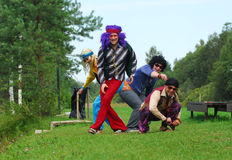 Adults in retro costumes. Adults in retro 1960s and 1970s themed costumes Stock Image
