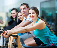 Adults riding stationary bicycles Stock Image