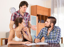 Adults signing financial documents Stock Photo