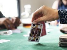 Adults socialising and playing cards Royalty Free Stock Photo