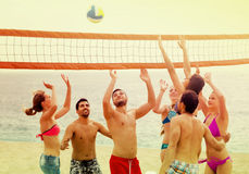 Adults throwing ball over net and laughing. American adults throwing ball over net and laughing royalty free stock photos