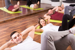 Adults training at fitness school Stock Photo