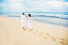 Adults in white. Adult couple vacation on the beach Stock Photo
