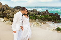 Adults in white. Adult couple vacation on the beach Royalty Free Stock Images