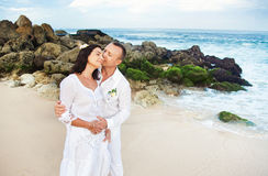 Adults in white. Romantic couple vacation on the beach Stock Image