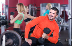 Adults working out in gym Stock Image