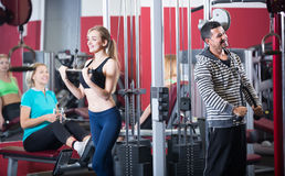 Adults working out in gym Stock Photos