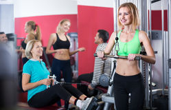 Adults working out in gym Royalty Free Stock Images
