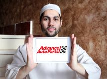 Advance Auto Parts logo. Logo of Advance Auto Parts on samsung tablet holded by arab muslim man. Advance Auto Parts is a retailer of automotive parts and Stock Photos