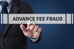 ADVANCE-FEE FRAUD. Businessman hands touching on virtual screen and blurred city background stock images