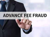 ADVANCE-FEE FRAUD. Businessman touching a touch screen on blurred city background stock images