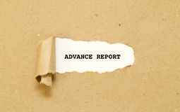 ADVANCE REPORT word written under torn paper. Stock Images