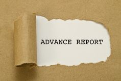 ADVANCE REPORT word written under torn paper. Stock Photography