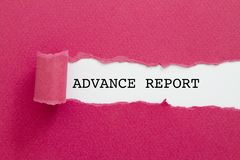 ADVANCE REPORT word written under torn paper. Stock Image