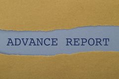 ADVANCE REPORT word written under torn paper. Royalty Free Stock Image