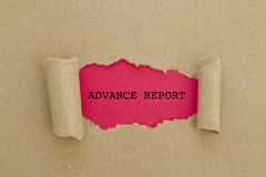 ADVANCE REPORT word written under torn paper. Royalty Free Stock Photos