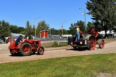 Advance steamer pulling McCormick W 30. DALTON, MINNESOTA, Sept 8, 2017: An old Advance steam engine pulls a McCormick Deering W 30 at the annual September Stock Photography