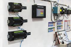 Advance technology and multipurpose automatic data collecting processor controller unit equipment for product or machine status. Monitoring in manufacturing stock photos