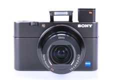 Advanced compact camera Sony DSC-RX100 M5 isolated on white. One of the best high-end compact cameras Stock Photography