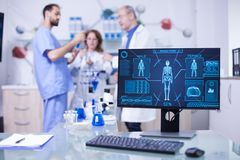 Advanced human body research displayed monitor in laborator. Researchers in human health stock image