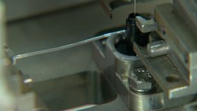 Close up on industrial production line for small parts, robotic arms stock video footage
