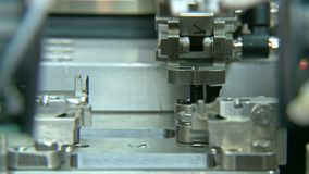 Advanced industrial production line for small parts, robotic arms working. Advanced industrial production line for small medical parts stock footage