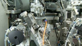 Advanced industrial production line for small parts, robotic arms working. Advanced industrial production line for small medical parts stock video