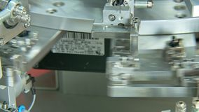 Advanced industrial production line for small parts, robotic arms working stock video