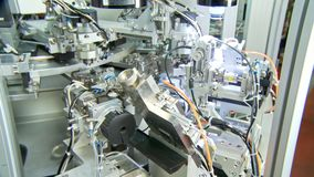 Advanced industrial production line for small parts, robotic arms working stock video footage