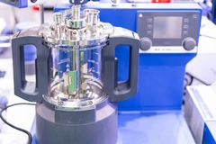 Advanced modular vacuum reactor vessel with direct drive stirrer inside device of lab for chemical reaction processes applications. In the industrial cosmetics stock image