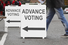 Advanced Voting Sign or Signage. A voter is on his way to cast a ballot at a local advanced polling station Stock Images