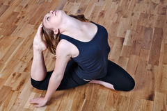 Advanced yoga. Young woman demonstrating an advanced yoga technique Stock Image